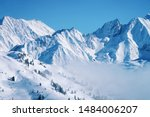 Small photo of Landscape in Zillertal Arena ski resort in clouds in Tyrol at Mayrhofen in Austria in winter Alps. Alpine mountains with white snow and blue sky. Downhill peaks at Austrian snowy slopes.