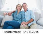 middle aged couple relaxing on... | Shutterstock . vector #148412045