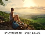 a girl sits on the edge of the...   Shutterstock . vector #148413101