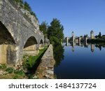 Two bridges. View of the Gothic Valentre Bridge on the right (14th century) and the Chartreus Fountain Bridge on the left side. City of Cahors. France.