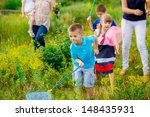 happy children in a clearing... | Shutterstock . vector #148435931