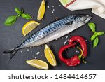 Stock photo raw mackerel with spices herbs and sea salt on black textured table top view 1484414657