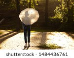 a girl with an umbrella on a... | Shutterstock . vector #1484436761