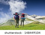 tourists in mountain. back view | Shutterstock . vector #148449104