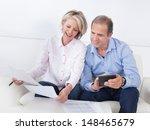 portrait of a couple sitting on ... | Shutterstock . vector #148465679