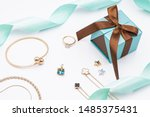 Small photo of Jewelry present, ring, necklace, bracelet, chain, tiffany string.