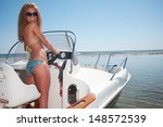 beautiful woman driving a motor ... | Shutterstock . vector #148572539