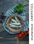 Stock photo baltic herring seafood salted herring fish in a bowl with spices and herbs wood background 1485957221