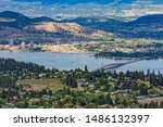 A view of the Kelowna Skyline, Okanagan Lake and the William R Bennett Bridge from Mount Boucherie in West Kelowna British Columbia Canada in the summer
