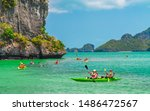 Beautiful nature scenic landscape of island with active outdoor Asian couple traveler kayaking, Water tourist people travel adventure Samui Thailand, Tourism destinations Asia Summer holiday vacation  - stock photo