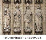 Four christian statues outside the cathedral of Our Lady in Antwerpen, Belgium  - stock photo