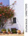 Typical House With Flower Pots in Mallorca, Spain ( Balearic Islands ) - stock photo
