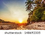 Stock photo tropical beach at beautiful sunset nature background 148692335