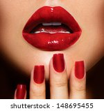 red sexy lips and nails closeup.... | Shutterstock . vector #148695455