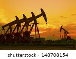 oil pump on orange sunset  | Shutterstock . vector #148708154