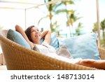 sofa woman relaxing enjoying... | Shutterstock . vector #148713014