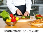 chef chopping vegetables on a... | Shutterstock . vector #148719389