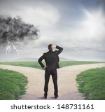 businessman at a crossroads... | Shutterstock . vector #148731161