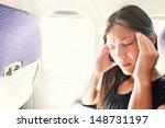 fear of flying woman in plane... | Shutterstock . vector #148731197