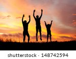silhouettes of people on the... | Shutterstock . vector #148742594