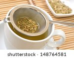 fennel tee and seeds in a sieve | Shutterstock . vector #148764581
