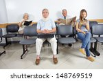 Different People Sitting In A...
