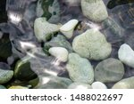 Small photo of looking at the pebble stones in the water through wobbling surface