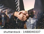 Small photo of Double exposure image of business people handshake on city office building in background showing partnership success of business deal. Concept of corporate teamwork, trust partner and work agreement.