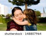 the little girl is kissing her... | Shutterstock . vector #148807964