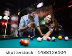 Happy young man playing snooker ...