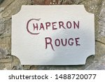 Small photo of French text: Chaperon rouge. English translation: Red Riding Hood. House name sign on a wall