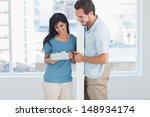 woman opening boyfriends gift... | Shutterstock . vector #148934174