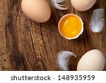 fresh eggs on wood background.... | Shutterstock . vector #148935959