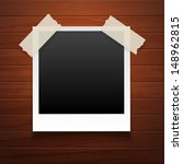 picture frame on a wood... | Shutterstock .eps vector #148962815