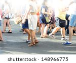 Pedestrian crowd crossing street - stock photo