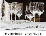 Fine restaurant dinner table place setting: napkin & wineglass - stock photo