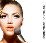 beauty girl with makeup brush.... | Shutterstock . vector #148983587