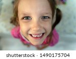little girl child changes teeth | Shutterstock . vector #1490175704