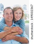 happy woman hugging her husband ...   Shutterstock . vector #149032367