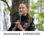 Small photo of New York, NY - August 28, 2019: 16-year-old climate activist Greta Thunberg arrives into New York City after crossing the Atlantic in a sailboat and attend press conference at North Cove Marina