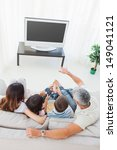 family with popcorn watching... | Shutterstock . vector #149041121