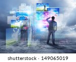 A businessman looking into visual media. - stock photo