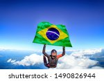 Brasil. Flag in skydiving. People in free fall grab flag of Brasil. Patriotism, men and flag.