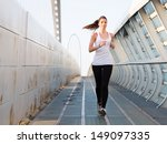 young woman running outdoors on ... | Shutterstock . vector #149097335