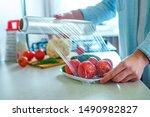 Woman packaged fresh vegetables using food film for food storage