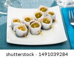 Stock photo delicious rolls of salted herring with pickled olives stuffed with bell pepper 1491039284