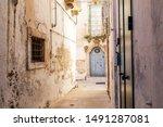 Italy, Apulia, Province of Taranto, Martina Franca. Narrow strets and buildings.