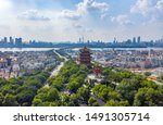 """Small photo of The yellow crane tower , located on snake hill in Wuhan, is one of the three famous towers south of yangtze river,China.4 Chinese letters on tower is """"Nang Xiong Gao Gong"""" means """"amazing heaven"""""""