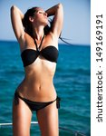 beautiful woman in bikini... | Shutterstock . vector #149169191