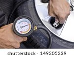 checking tire pressure. pumping ... | Shutterstock . vector #149205239